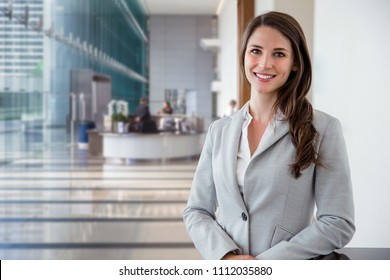 Career motivated successful female business professional standing proud and confident inside downtown financial building