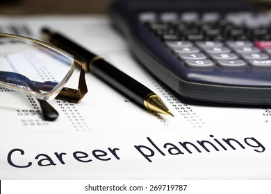 Career planning. Career opportunities management concept. Glasses pen and calculator in the background.
