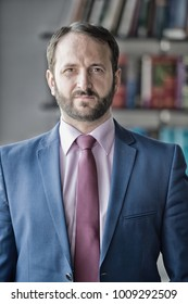 Career, profession, work. Businessman or director pose in office. Business, entrepreneurship concept. Fashion, style, dress code. Man with beard in blue jacket, shirt and tie, vintage filter