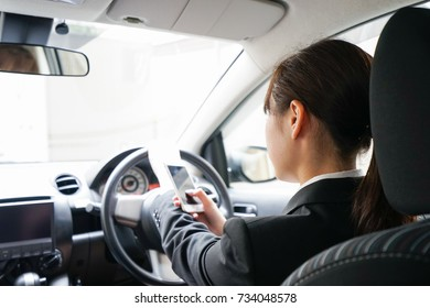 Career woman telephoning in car