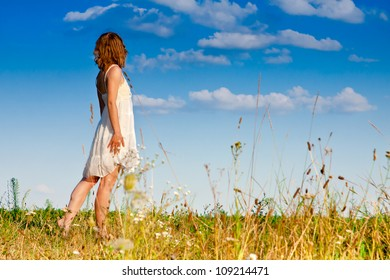 carefree adorable woman in field