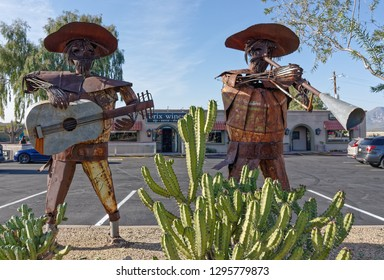 Carefree, AZ - November 21, 2018: Musician sculptures crafted from metal stand in front of the Mariachi Plaza on the corner of E Cave Creek Rd and N Tom Darlington Dr.
