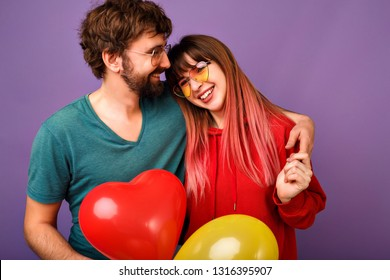 Carefree blithesome young hipster couple hugs and smiling, romantic mood, love and family, close up studio portrait of happy woman and handsome bearded man, casual clothes, positive mood.