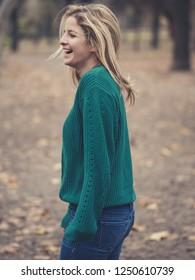 Carefree blonde woman walking outdoor