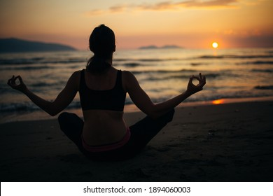 Carefree calm woman meditating in nature.Finding inner peace.Yoga practice.Spiritual healing lifestyle.Enjoying peace,anti-stress therapy,mindfulness meditation.Positive energy.Chakra balancing