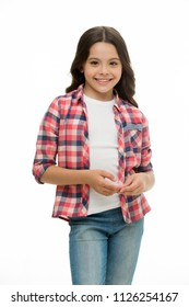 Carefree and casual. Girl cute checkered shirt and denim pants looks happy cheerful. Child girl happy carefree enjoy childhood. Kid girl long curly hair cheerful happy, isolated white background.