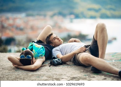 Carefree couple relaxing,looking at the cityscape view.Making a company.Stress free,freedom feeling.Happiness and mindfulness.Serene relationship.Soul mates.Best friends hanging out.Deep conversation