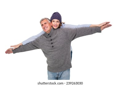 Carefree couple in warm clothing on white background