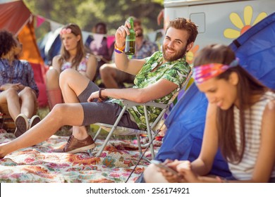 Carefree hipster relaxing on campsite at a music festival