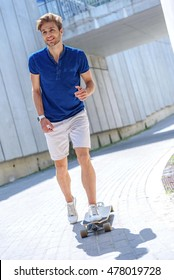 Carefree man is riding skate outdoors