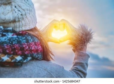 carefree woman holding winter sun