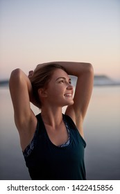 Carefree woman looking up and smiling after workout