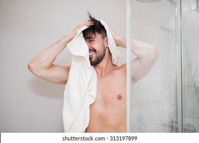 Carefree young man after taking shower