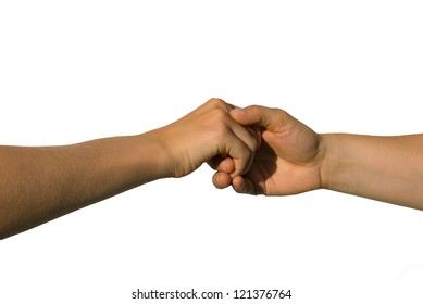 a careful handshake between two young hands, isolated on white