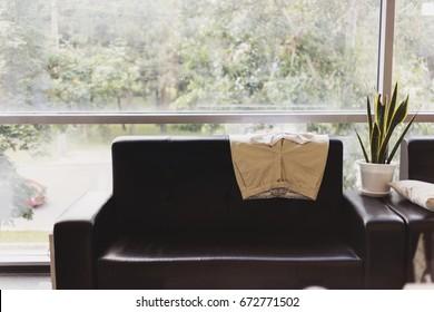 Careful laying pants on the sofa