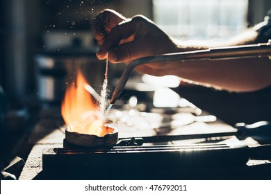 Carefully bringing metal up to temperature in a crucible