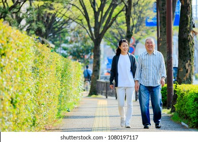 Caregiver and Asian senior male