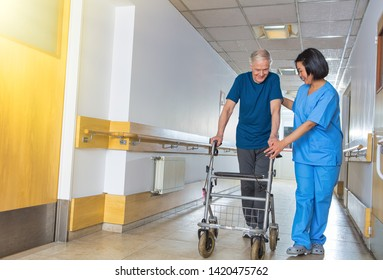 Caregiver assisting senior retired man at hospital.