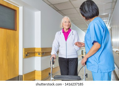 Caregiver assisting senior retired woman at hospital.