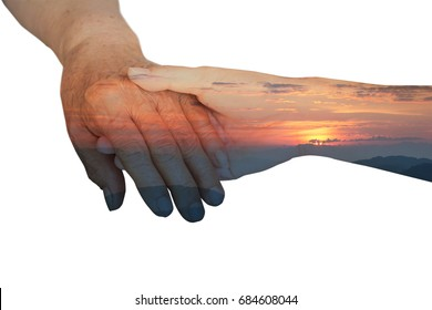 Caregiver, carer hand holding elder hand in hospice care with double exposure sunrise effect. Philanthropy kindness to disabled old people concept.