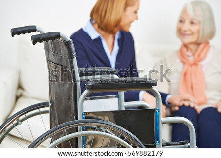 Caregiver from home nursing service for senior woman with wheelchair
