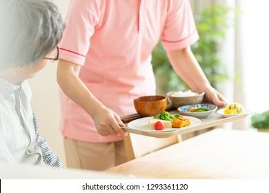 A caregiver preparing meals