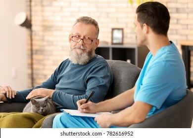 Caregiver with senior man at home