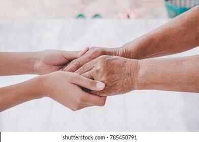 Caregiver,Children hold hands with the elderly