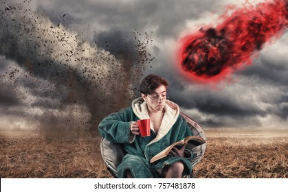 Careless man drinking coffee and reading a book while a tornado and a meteor coming to him.
