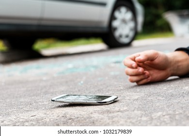 Careless person hit by a car after crossing the road while talking on the phone
