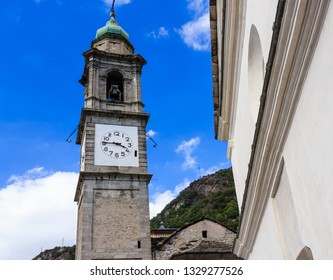 Carema,Italy- September,2018:  bell tower of the parish church of San Martino  dedicated to the bishop San Martino of Tours/the bell tower,  an architectural masterpiece built in the years 1762-1769