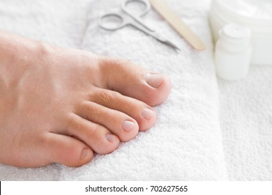 Cares about men's feet nails. Pedicure, manicure beauty salon concept. Scissors and nail file on the white towel.