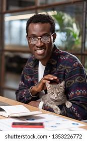 Caressing a cat. A man caressing a cat to reduce stress