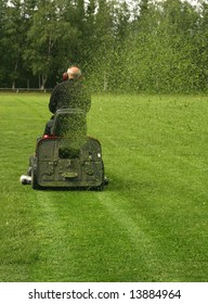 Caretaker mowing a soccer field