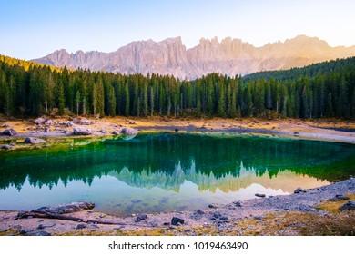 Carezza lake( (Lago di Carezza) ) and Mount Latemar in Dolomites Alps . Italy