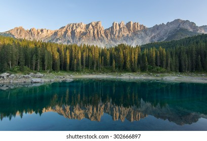 The Carezza lake on sunset with Latemar that is reflecting on the water