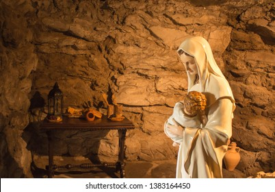 Carfin, Scotland - 18 April 2018: Statue of Virgin Mary Holding Baby Jesus. Photo Taken in Carfin Grotto, free entry to public