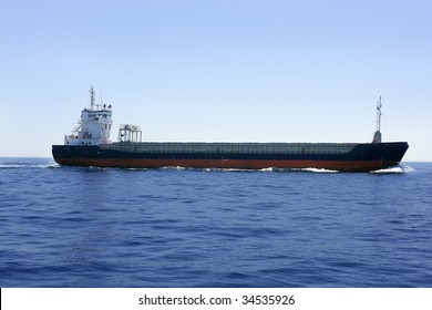 Cargo boat in a blues sea and sky over Mediterranean
