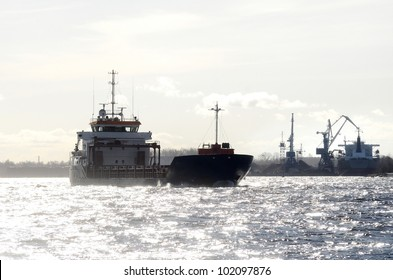cargo chip silhouette against shiny water