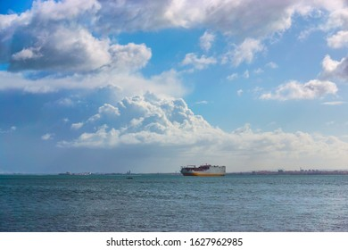 Cargo container Ship arriving into River Tagus Lisbon Port, Portugal
