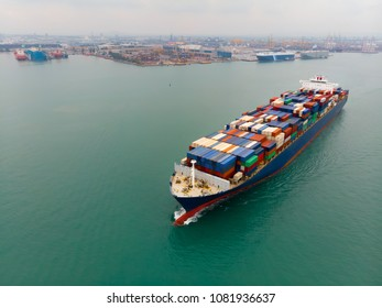 Cargo container ship carrying container import and export  goods running around container yard port concept freight shipping ship.