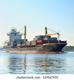 cargo container ship leaving port of Riga