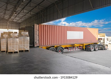 Cargo Container, Trailer Truck Parked Loading Package Boxes at Dock Warehouse. Supply Chain. Cargo Shipment. Industry Freight Truck Transportation. Shipping Warehousing Logistics.