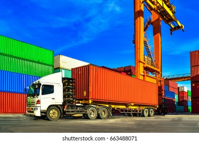 Cargo container truck picking up container at yard. Port logistics, container yard operation.
