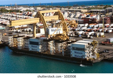 Cargo containers being loaded in Honolulu Harbor, Oahu Hawaii.