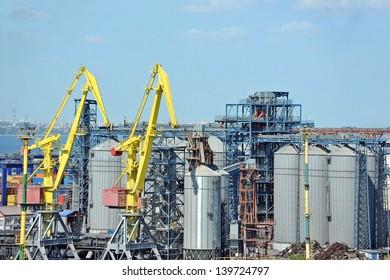 Cargo crane and grain dryer in port Odessa, Ukraine