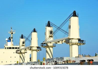 Cargo cranes on bulk carrier ship deck