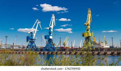 cargo cranes in a river port