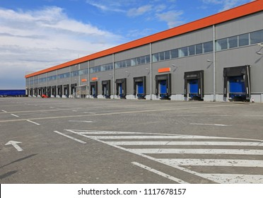 Cargo Dock Ramps for Loading Trucks at Long Distribution Warehouse