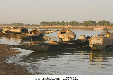 cargo dows on the NIger River of mali, wait for passengers to cross the river.
